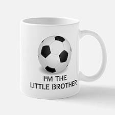 Im the little brother soccer ball Mugs