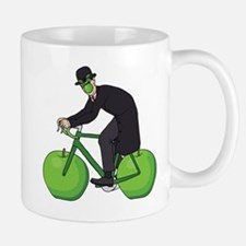 Son Of Man Riding Bike With Apple Wheels Mugs