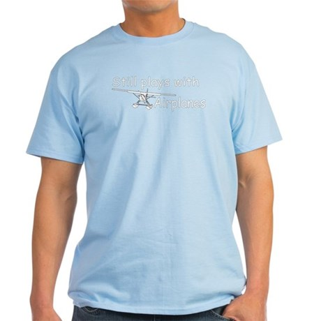 """Still Plays with Airplanes"" Light T-Shirt"