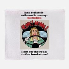 Bookaholic on road to recovery Throw Blanket