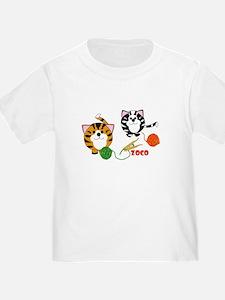 Friendly kitten and funny yarn ball kids T-shirt