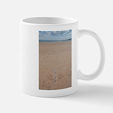 arrow on beach Mugs