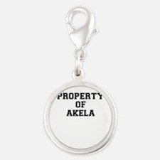 Property of AKELA Charms