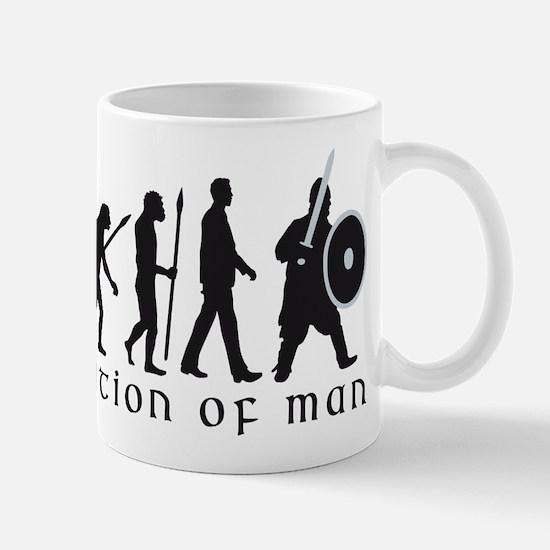 Evolution of man knight with sword Mugs
