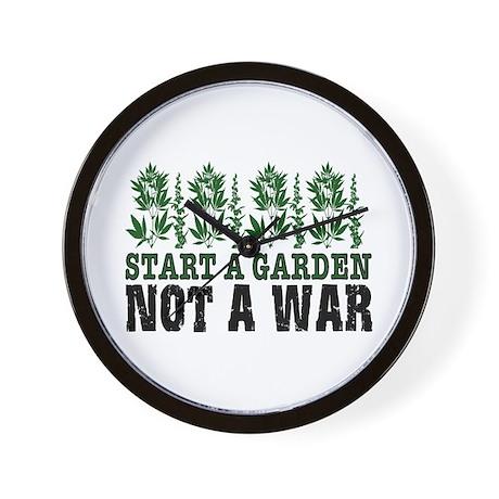 START A GARDEN NOT A WAR Wall Clock