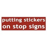 putting stickers on stop signs (sticker)