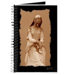 New Orleans cemetery statue Journal