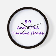 89 Still Turning Heads 1C Purple Wall Clock
