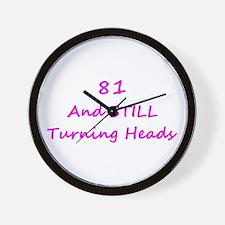81 Still Turning Heads 1C Pink Wall Clock