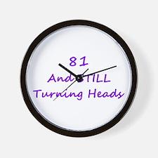 81 Still Turning Heads 1C Purple Wall Clock