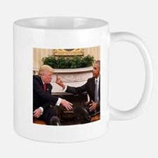 barack obama giving donald trump the middle f Mugs