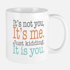 It's Not Me Just Kidding III Mugs