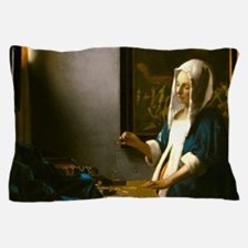 Woman Holding a Balance by Johannes Vermeer Pillow