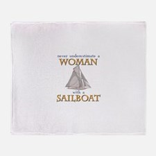Woman with sailboat Throw Blanket