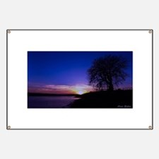 A Tree,a River, and a Sunset Banner