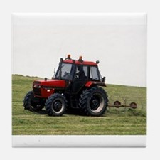 A Red Tractor On The Go Tile Coaster