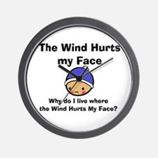 THE WIND HURTS MY FACE Wall Clock