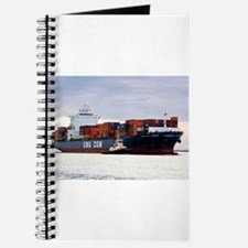 Container cargo ship and tug Journal