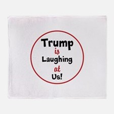 Trump is laughing at the USA Throw Blanket