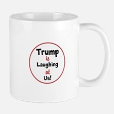 Trump is laughing at the USA Mugs