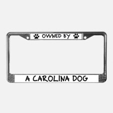 Owned by a Carolina Dog License Plate Frame