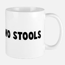 Between two stools Mug