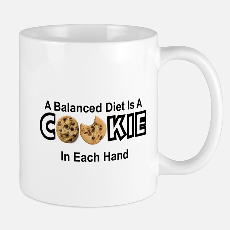 A BALANCED DIET IS A COOKIE IN EACH HAND Mugs