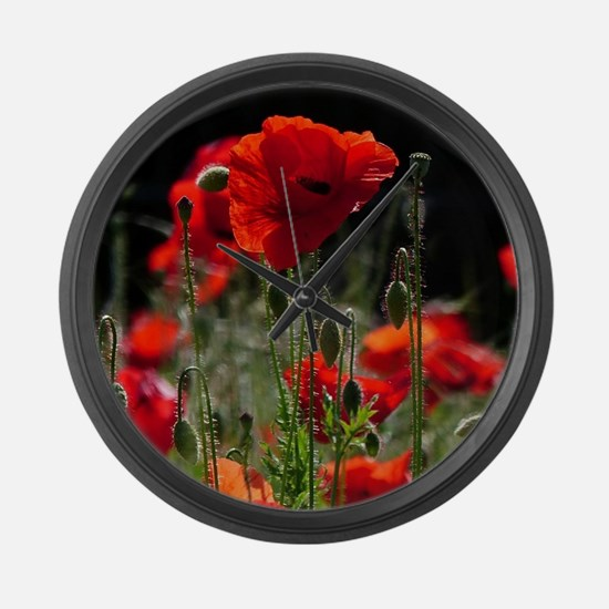 Red Poppies in bright sunlight Large Wall Clock