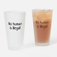 No Human Is Illegal Drinking Glass