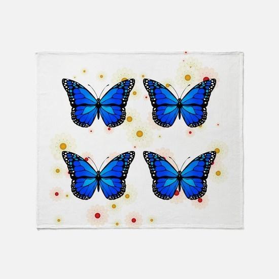 Four blue butterflies Throw Blanket