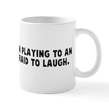 God is a comedian playing to  Mug