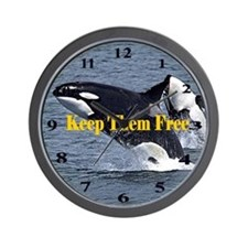 Dolphins Keep Them Free Wall Clock