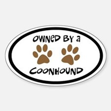 Owned By A Coonhound (black border) Oval Decal