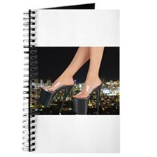 Stiletto's in front of a city Journal