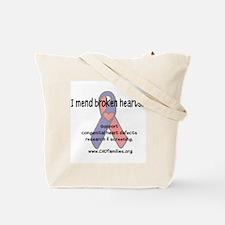 I mend broken hearts Tote Bag