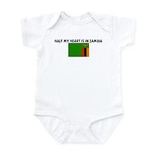 HALF MY HEART IS IN ZAMBIA Infant Bodysuit