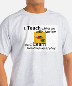 teach, learn autism T-Shirt