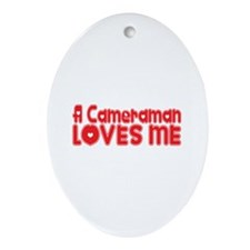 A Cameraman Loves Me Oval Ornament