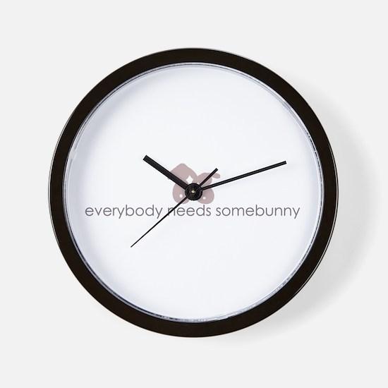 everybody needs somebunny Wall Clock