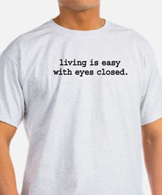 living is easy with eyes closed. T-Shirt