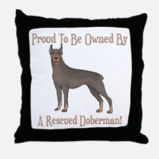 Proudly Owned By A Rescued Doberman Throw Pillow