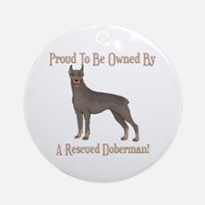 Proudly Owned By A Rescued Doberman Ornament (Roun