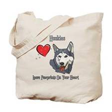 Huskies Leave Paw Prints Tote Bag