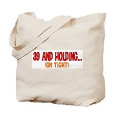 39 and holding Tote Bag