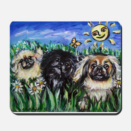Happy Pekes under the smiling Mousepad