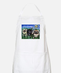 Happy Pekes under the smiling BBQ Apron