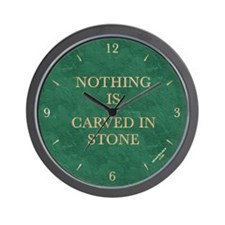'NOTHING IS CARVED IN STONE' wall clock - green