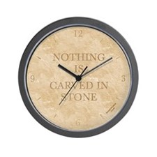 'NOTHING IS CARVED IN STONE' wall clock  - ivory