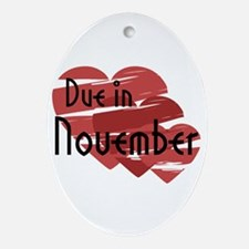 Due In November Red Hearts Oval Ornament