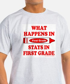 WHAT HAPPENS IN FIRST GRADE T-Shirt